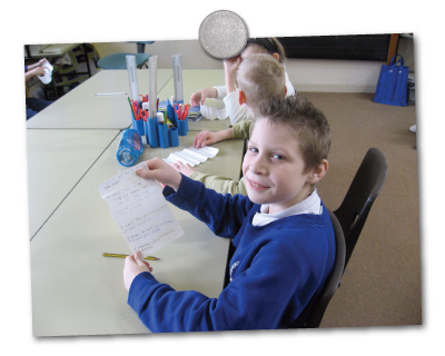 Pupil writing a report about sustainable transport