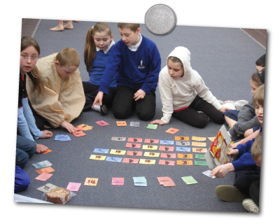 pupils playing the eco card game
