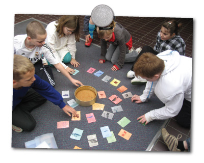 kids playing the where's the impact card game